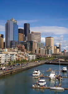 The shimmering downtown area of Seattle is bordered on one side by the city's chief harbor - Elliott Bay, an inlet of Puget Sound.