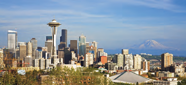 The striking Seattle skyline with Space Needle left of center, forefront, and gorgeous Mount Rainier right of center, in the background.