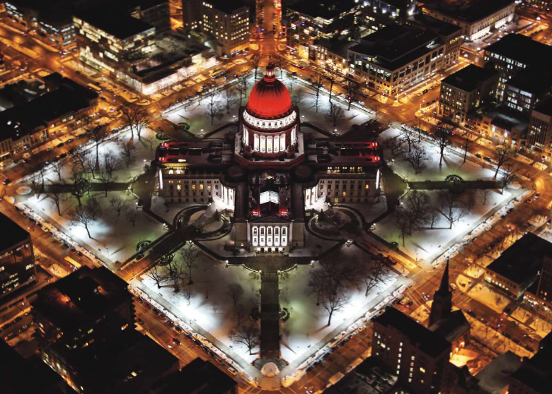 The state capitol building illuminates the heart of downtown in February as it stands tall, lit for American Heart Month.