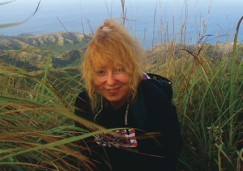 Kathy Fedack, M.D., on the summit of Mt. Lamlam in Guam. The base of Mt. Lamlam rises from the bottom of the Mariana Trench - making it one of Earth's highest mountains.