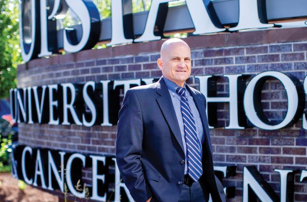 As chief resident, Robert Corona, D.O., discovered a love for leading others. He's now CEO of Upstate University Hospital. - Photo by Leo Timoshuk