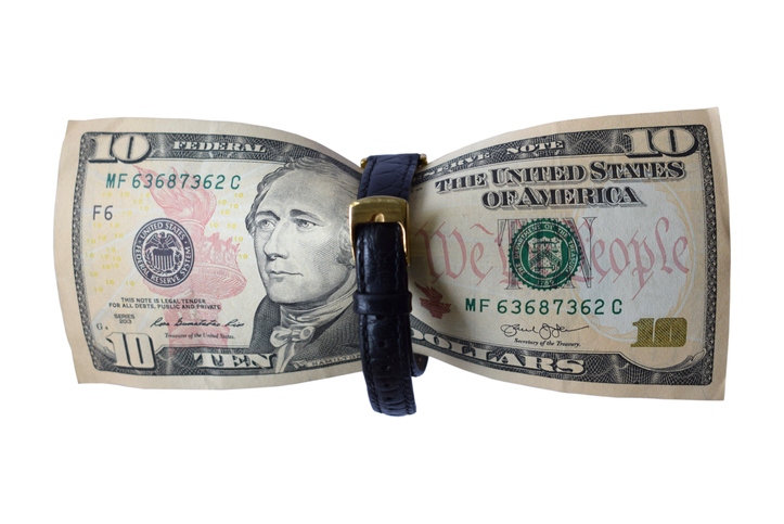 A 10 dollar bill with a black strap in the middle.