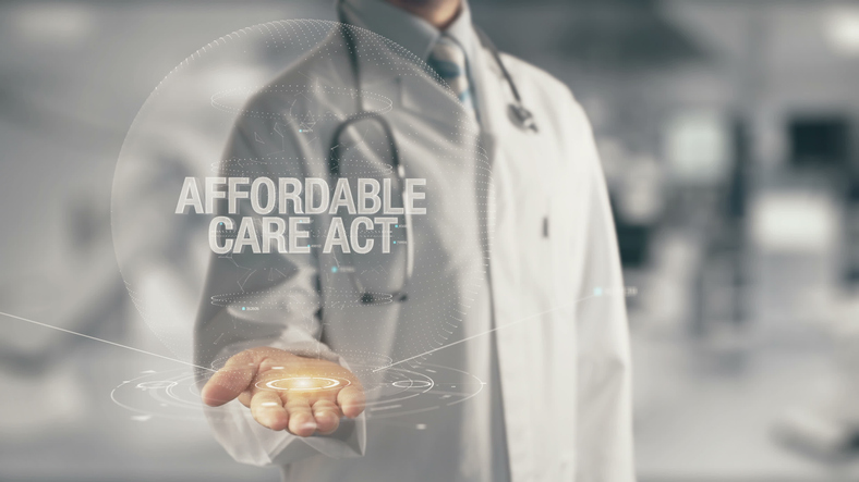 Doctor holding in hand Affordable Care Act