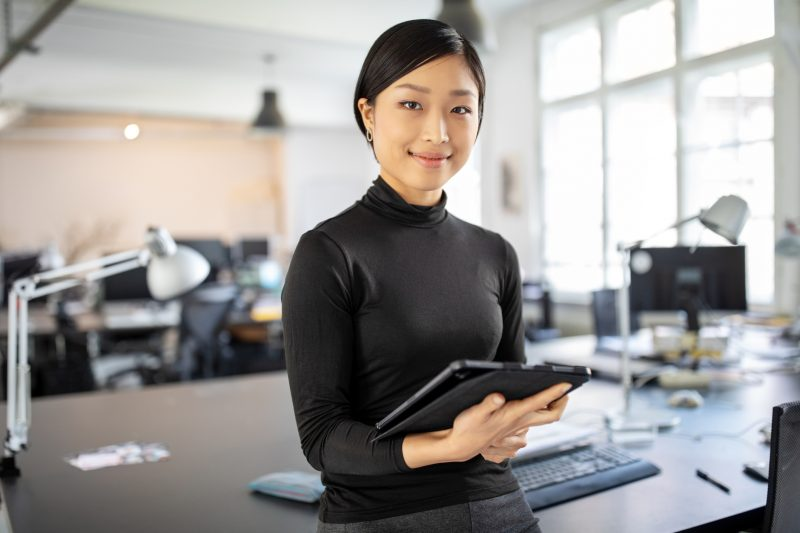 Confident asian businesswoman in office